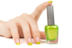 Woman's hand with a bottle of green nail polish stock image