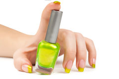 Woman's hand with a bottle of green nail polish Stock Photography