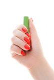Woman`s hand with a bottle of nail paint. Girl holding in hands a small bottle with colored lacquer. Beautifully painted nails. Acrylic, gel, hand care, beauty royalty free stock image
