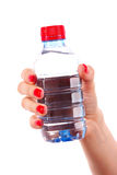 Woman's hand and bottle of water Stock Photo