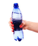 Woman's hand and bottle of water isolated Stock Photos