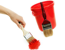 Woman's hand with  brush and  red bucket. Stock Photography