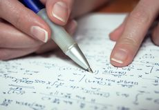 Woman's hand calculating. Close up Royalty Free Stock Images