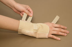 Woman's hand with carpal tunnel syndrome. Remove the wrist brace Stock Image