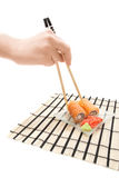 Woman's hand with chopsticks and maki sushi Royalty Free Stock Photos