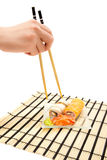 Woman's hand with chopsticks and maki sushi Royalty Free Stock Image