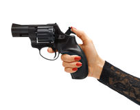 Woman's hand cocking revolver gun. Royalty Free Stock Images