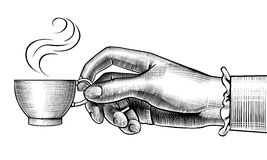 Woman`s hand with a coffee cup Stock Photo