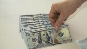 Woman`s hand counts money on white background stock footage