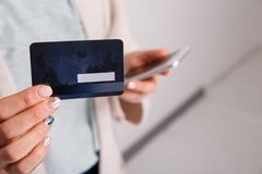 Woman`s hand with credit card and phone isolated. Woman`s hand with credit card and phone isolated royalty free stock photography