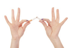 Woman's hand crushing cigarette Royalty Free Stock Photos