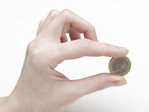 Woman's hand delivering a 1 euro coin Royalty Free Stock Photography