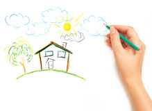 Woman's hand drawing the dream home Stock Photography
