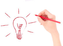 Woman's Hand drawing light bulb Stock Photography