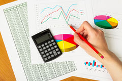 Woman's hand draws  graph on the background of an office desk Stock Images