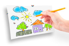 Woman's hand and dream home Stock Photography