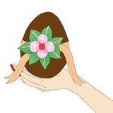 Woman's hand with Easter egg Stock Photos