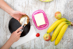 A woman's hand with food Royalty Free Stock Images