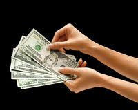 Woman's hand is giving dollars money. Stock Photo