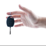Woman's hand giving key from car. Woman's hand giving key from modern car. Isolated on white background Stock Image