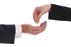 Woman's hand giving money to a businessman. Isolated on a white background stock images