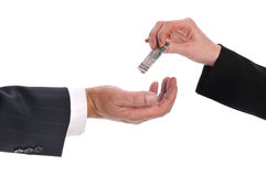 Woman's hand giving money to a businessman. Isolated on a white background royalty free stock photos