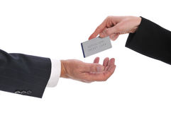 Woman's hand giving money to a businessman Stock Image