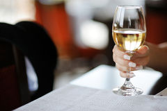 Woman's hand with a glass of wine royalty free stock image