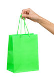 Woman's hand and green shopping bag Stock Photography