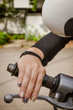 Woman's hand grip motorcycles. The Woman's hand grip motorcycles Royalty Free Stock Photography
