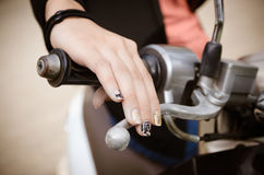 Woman's hand grip motorcycles. Royalty Free Stock Images