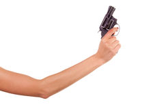 Woman's hand with a gun. Isolated on white Stock Photography