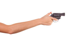Woman's hand with a gun Royalty Free Stock Photos