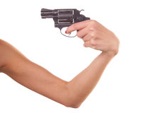 Woman's hand with a gun Royalty Free Stock Images