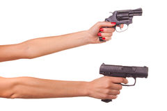 Woman's hand with a gun Stock Images