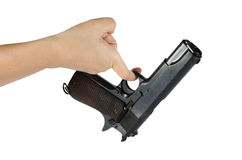 Woman's hand with gun Stock Image
