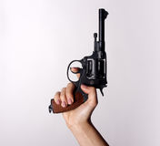 Woman`s hand with a gun. On a white background Stock Image