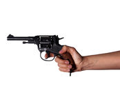 Woman`s hand with a gun. On a white background Royalty Free Stock Photo