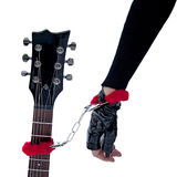 Woman's hand handcuffed to the guitar Stock Photography