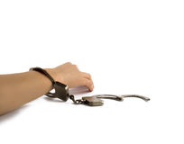 Woman's hand in handcuffs. Elegant female hand stiffness in handcuffs Royalty Free Stock Photography