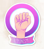 Woman's hand with her fist raised up. Girl Power. Feminism conce Stock Images