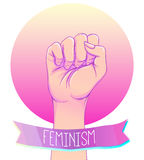 Woman's hand with her fist raised up. Girl Power. Feminism conce Stock Photo