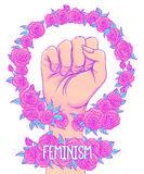 Woman's hand with her fist raised up. Girl Power. Feminism conce Royalty Free Stock Photo