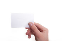 Woman's hand hold blank card isolated over white Royalty Free Stock Image