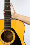 Woman's hand holding acoustic guitar on white background Stock Photography