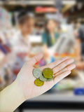 Woman's hand holding Australian coins Royalty Free Stock Photo