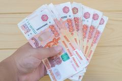 Woma`s hand holding bank notes roubles Royalty Free Stock Photos