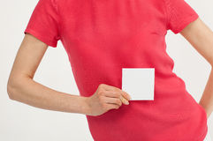 Woman's hand holding blank white sticker Royalty Free Stock Photos