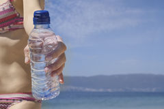 Woman's hand holding bottle of water Royalty Free Stock Photography