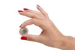 Woman's hand holding a Brazilian coin Royalty Free Stock Image